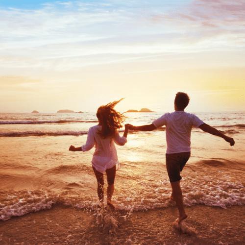 Couple running in ocean image